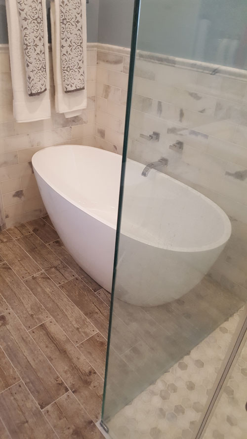 Bath remodel with modern tub